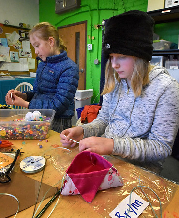 BRYAN EATON/Staff photo. Molly Bernard, left, and Brynn Ponting, both 11, finish the drawstring on their jewelry pouch which they will fill with candy for Valentine's Day. They made the pouches in sewing club under the guidance of Susan McIntire at the Newburyport Rec Center.