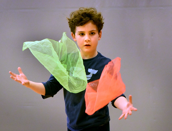 BRYAN EATON/Staff photo. Brendan Kelley, 6, advances to tossing two scarves from one at the Bresnahan School in Newburyport. First grade students in Cathy Hill's physical education class were learning juggling to work on eye to hand coordination.