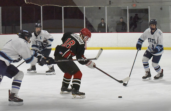 BRYAN EATON/Staff photo. Amesbury's Patrick Birmingham moves the puck into Triton ice.