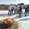 JIM VAIKNORAS/Staff photo  Employees of Keiver-Willard Lumber Co. gather around a fire pit at a Patriots tailgate party Friday to celebrate New England playing in this years Superbowl.