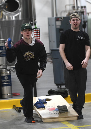 JIM VAIKNORAS/Staff photo Alex Burly on Hudson and Derek Fraioli of Haverhill compete at the  Double Trouble ACL sanctioned cornhole tournament to benefit Nourishing the North Shore at Riverwalk Brewery in Newburyport Sunday.