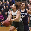 BRYAN EATON/Staff photo. Angelina Yacubacci is fouled by Wilmington's Gabriella Bond.