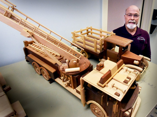 BRYAN EATON/Staff photo. Amesbury buliding inspector Denis Nadeau is retiring from the position after 25 years, so now will spend more time building his wooden models of trucks.