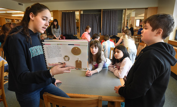 BRYAN EATON/Staff photo. The sixth grade Blue Team at Amesbury Middle School shared historical fiction narratives that they completed using their own research, drafting, revising, editing, and illustrating to present to third-graders from the Cashman and Amesbury Elementary Schools. Jordan Bennet, left, 12, with project partner Maddox Nikas, 11, right present their project on ancient Egypt to Samantha Smith, second from left, and Amali Steward, both 9.