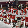 BRYAN EATON/Staff photo. The Amesbury High hockey team and fellow students on the bleachers observed a moment of silence in memory of Troy Marden who died over the weekend in a snowmobiling accident.