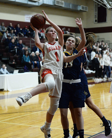 CARL RUSSO/staff photo. Amesbury's McKenna Hallinan drives to the hoop against Lynnfield's Lucy Cleary. Amesbury girls basketball vs. Lynnfield in Division 3 North semifinals. 3/6/2019