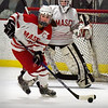 BRYAN EATON/Staff photo. Anna Behringer moves the puck away from her goalie Molly Elmore.
