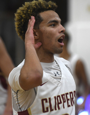JIM VAIKNORAS/Staff photo Newburyport's George Coryell encourages the crowd after the Clipper's last second victory over Swampscott at Newburyport High School Monday night.