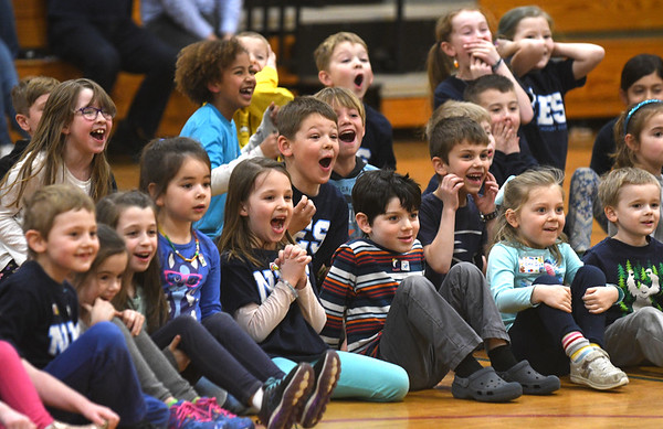 JIM VAIKNORAS/Staff photo Students at the Newbury Elementary School react as their principal Beth Yando rides a mechanical bull  in the school gym Wednesday.