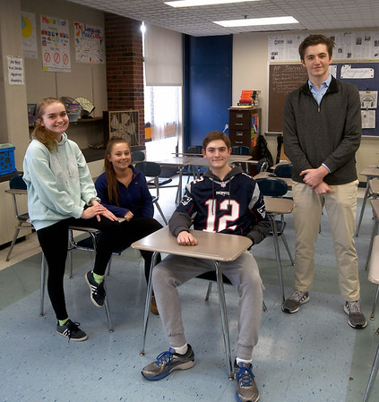 JIM VAIKNORAS/Staff photo  Staff members Bridget Tucker of Rowley, Sophia Agrella, of Rowley, Alexander Michals, of Byfield, and Andrew Valianti of Newbury of Triton High School student newspaper,The Voice,  talk about their story on vaping.