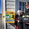 BRYAN EATON/Staff photo. Project orgnaizer Peggy Poppe, left, and Newbury Police Sgt. Stephen Jenkins show off the new AED station, with emergency phone, at Plum Island Center.