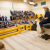 """JIM VAIKNORAS/Staff photo Newbury Elementary School principal Beth Yando rides a mechanical bull to the strains of Lynyrd Skynyrd """"Sweet Home Alabama"""" in the school gym Wednesday. Yando surprised the students as a reward for the school raising over $23,000 for the PTA. Student were asked for suggestions for the reward and she picked one by second graders Kodi Koch and Evan Allen.  A number of teachers and staff members took a turn on the bull."""