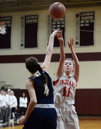 CARL RUSSO/staff photo. Amesbury's Avery Hallinan takes the jump shot over Lynnfield's Catherine MacDonald. Amesbury girls basketball vs. Lynnfield in Division 3 North semifinals. 3/6/2019