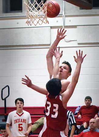 BRYAN EATON/Staff photo. Noah Lynch goes for two points as Masconomet guard Tim Volchuk covers.