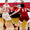 BRYAN EATON/Staff photo. Masco's Tim Volchuk covers Lynch as he looks for an open teammate.