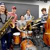 BRYAN EATON/Staff photo. Members of Pentucket High School's award-winning jazz band, from left, Zack Murphy, Jake Baynes, John Davis, Quinn McCarron and Mac Mansfield-Parisi.