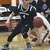 JIM VAIKNORAS/Staff photo Swampscott's Jake Goldman makes a move at Newburyport High School Monday night.