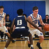 BRYAN EATON/Staff photo. Hunter Lane moves past a Lynnfield defender.