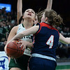 CARL RUSSO/staff photo. Pentucket's Mackenzie Currie fights her way to the hoop against Pembroke's Sophie Considine. The Pentucket Sachems defeated Pembroke 53-38 in D2 girls basketball state semifinals at the Boston Garden. 3/13/2019