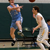 JIM VAIKNORAS/Staff photo Triton's Quintin McHale save a ball from going out of bounds at North Reading Thursday night.