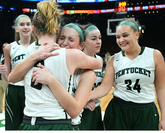 CARL RUSSO/staff photo. Pentucket's Anna Wyner and Jessica Galvin (front) hug each other as the team  celebrates. The Pentucket Sachems defeated Pembroke 53-38 in D2 girls basketball state semifinals at the Boston Garden. 3/13/2019