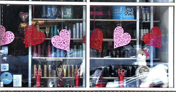 JIM VAIKNORAS/Staff photo Supercuts window is decked out in hearts for Valentines Day as part of the Amesbury Chamber of Commerce February promotion.