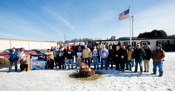 JIM VAIKNORAS/Staff photo  Employees at Keiver-Willard Lumber Co. in Newburyport brave the cold Friday at a tailgate party to celebrate the Patriots playing in this years Superbowl.