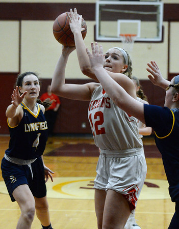 CARL RUSSO/staff photo. Amesbury's Flannery O'Connor fights her way to the hoop. Amesbury girls basketball vs. Lynnfield in Division 3 North semifinals. 3/6/2019