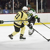 BRYAN EATON/Staff photo. Haverhill's Casey Langley moves the puck into Pentucket ice as Alex Satkus, left, and Deuce Purcell cover.