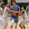 JIM VAIKNORAS/Staff photo Triton's Max McKenzie gets teid up at North Reading Thursday night.