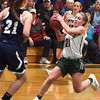 BRYAN EATON/Staff photo. Madeline Doyle tries for two points as Wilmington's Olivia Almeida covers.