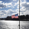 BRYAN EATON/Staff photo. This American flag on Amesbury's Point Shore flies in a stiff wind coming down the Merrimack River on Monday morning. The wind continues Tuesday, though not a strong, and the temperature dips some as well.