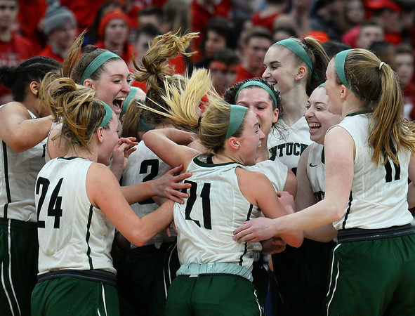 CARL RUSSO/staff photo. Pentucket Sachem's celebrate. The Pentucket Sachems defeated Pembroke 53-38 in D2 girls basketball state semifinals at the Boston Garden. 3/13/2019