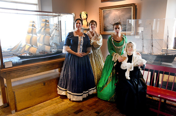 "JIM VAIKNORAS/Staff photo Shannon Mohs as Fannie Brae, Sally Nutt as Mary Lunt Graves , Allegra Larson as Carolyn Graves and Maureen Daley as Suzannah Graves pose in costume at the Custom House in Newburyport. They will be giving a performance of ""Captains Wives and Daughters""  to members in March."