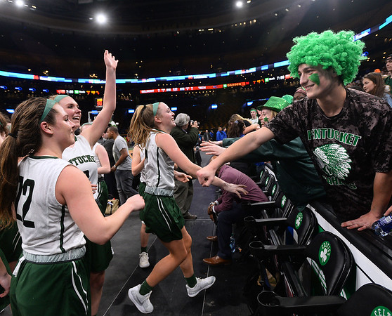 CARL RUSSO/staff photo. Pentucket fans celebrate with the team. The Pentucket Sachems defeated Pembroke 53-38 in D2 girls basketball state semifinals at the Boston Garden.  3/13/2019