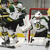 BRYAN EATON/Staff photo. Pentucket goalie Brady McClung stops a shot by Haverhill.