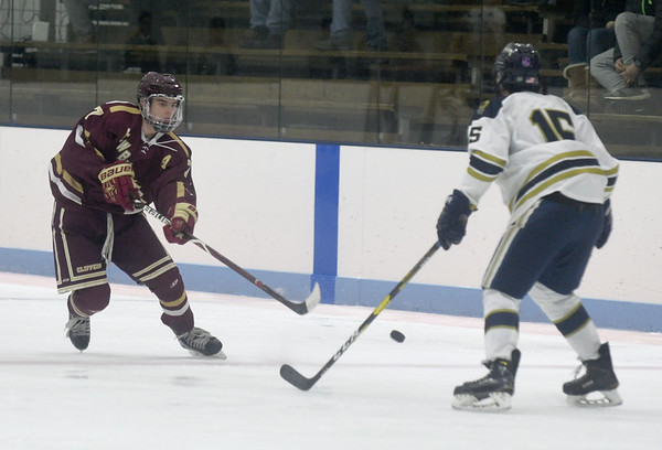 JIM VAIKNORAS/Staff photo Newburyport's Patrick Leary clears the puck past St Mary's Colby Magliozzi at Connery Rink in Lynn Wednesday night.