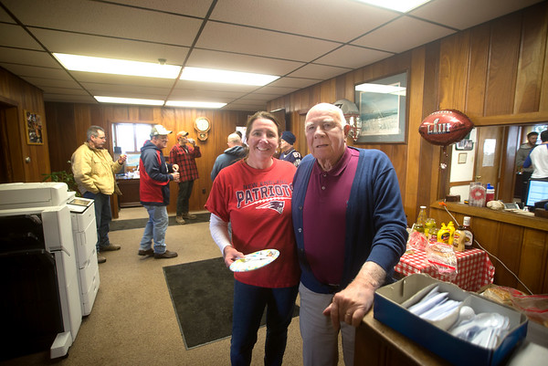 JIM VAIKNORAS/Staff photo Company president Patti Heintzeiman and her dad Bob Keiver along with rest of the employees of Keiver-Willard Lumber Co. enjoy a Patriots tailgate party Friday to celebrate New England  playing in this years Superbowl.