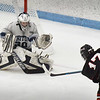 BRYAN EATON/Staff photo. Triton goalie Ben Fougere makes the save on a shot by Cole Fagan.