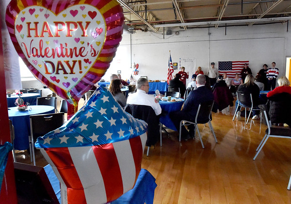 BRYAN EATON/Staff photo. Coastal Connections in Amesbury held a Valentine's Day coffee hour to honor veterans on Thursday morning. Clients of the organization that helps those with disabilities achieve their potential lined up to applaud as veterans entered the building.
