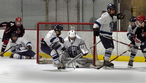 BRYAN EATON/Staff photo. Triton goalie Justin Szymanski makes a save on an Amesbury shot.