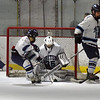 BRYAN EATON/Staff photo. Triton goalie Justin Szymanski makes a save on an Amesbury shot.