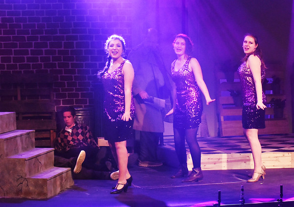 """BRYAN EATON/Staff photo. Three female street urchins who function as participants in the action and as """"doo-wop"""" chorus girls outside it often sing directly to the audience in a hip, narrative style."""