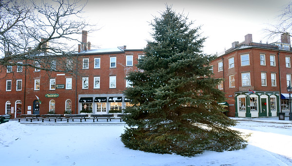"""BRYAN EATON/Staff photo. The Christmas tree in Newburyport's Market Square will be coming down, but another tree will be put up soon so a Hallmark film, """"A Ring for Christmas,"""" can be filmed there at the end of February."""