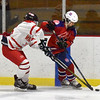 BRYAN EATON/Staff photo. Abby Gendron, left, and Methuen's Brenna Greene vie for control of the puck.