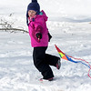 JIM VAIKNORAS/Staff photo Cora Reardon, 5, runs to get her kite in the air at the Winter Kite Festival at Maudslay State Park co sponsored by Newburyport Youth Services and Kites over New England Saturday.