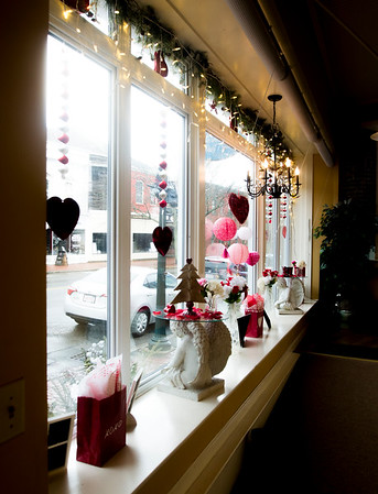 JIM VAIKNORAS/Staff photo Bernadette's Day Spa window is decked out in hearts for Valentines Day as part of the Amesbury Chamber of Commerce February promotion.