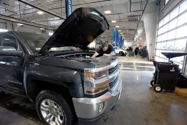BRYAN EATON/Staff photo. Adam Sachetti in the Amesbury Chevrolet service department.