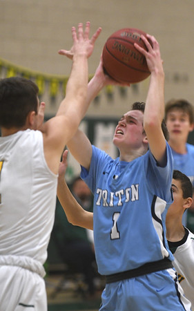 JIM VAIKNORAS/Staff photo Triton's TJ Overbaugh drives to the basket at North Reading Thursday night.