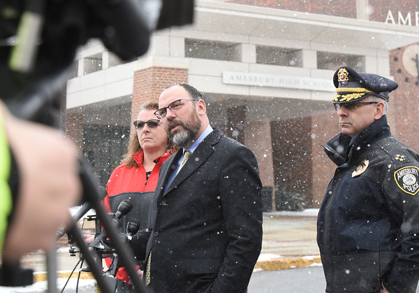 BRYAN EATON/Staff photo. Amesbury Schools superintendent Jared Fulgoni is flanked by high school principal Elizabeth McAndrews and police Chief William Scholtz during a press conference.